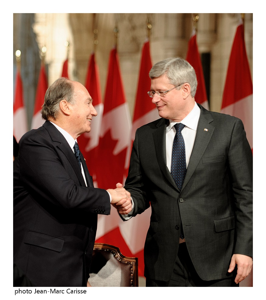 His Highness the Aga Khan and Prime Minister Stephen Harper congratulate each other after signing a Protocol of Understanding between the Ismaili Imamat, a 1400 year hereditary Institution, and Canada. Photo: Jean-Marc Carisse. Copyright.