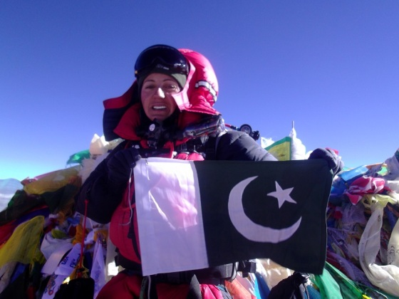 At the top - Samina Baig on Mount Everest with the flag of Pakistan. Photo: Samina Baig collection. Copyright.