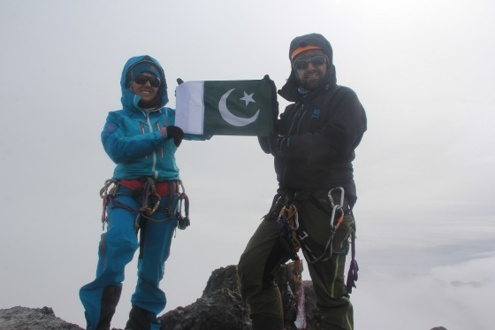 Samina Baig and and Mirza Ali  at summit of Indonesi'a Mt. Puncak Jaya (4884m), also known as Carstensz Pyramid,  the highest mountain in the continent of Australia. They reached the summit on March 19, 2014. Photo: Samina Baig Facebook page.