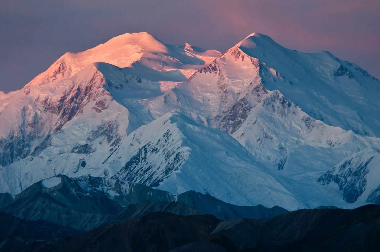Sunrise alpenglow on Mount McKinley, Alaska. Photo by: National Park Service /Tim Rains