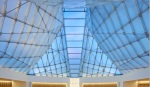 Inside the Jamatkhana, the central skylight panel descends to a white translucent onyx block.