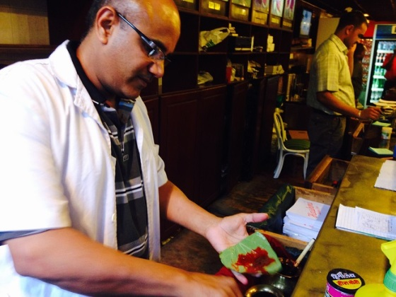Farouk Panwalla preparing a sweet paan with a red paste. Photo: Shariffa Keshavjee.