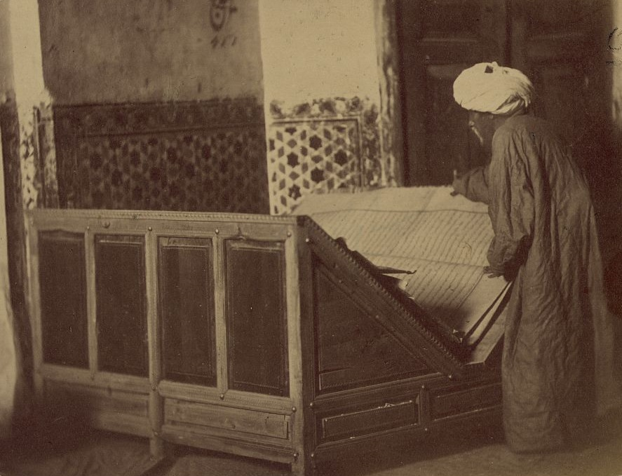 Tomb of the Saint Kassim ibn Abass (Shakh Zinde) and adjacent mausoleums. Mosque (khanaka) of Shakh Zinde. Reading-stand with a Koran donated by Emir Nasrulla of Bukhara. photographer: N.V. Bogaevskīĭ, btween 1862 and 1872. Repository/Credit: Repository: Library of Congress Prints and Photographs Division Washington, D.C. 20540 USA. photographer