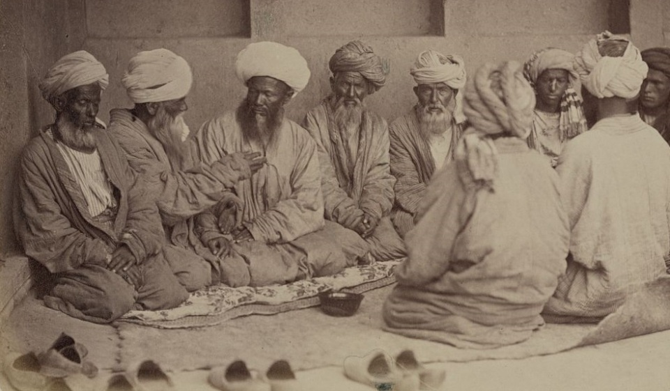 Photograph shows a group of men seated on the ground as part of rituals at a Tajik wedding. Date created/published between 1865 and 1872. Credit/Repository: Repository: Library of Congress Prints and Photographs Division Washington, D.C. 20540 USA