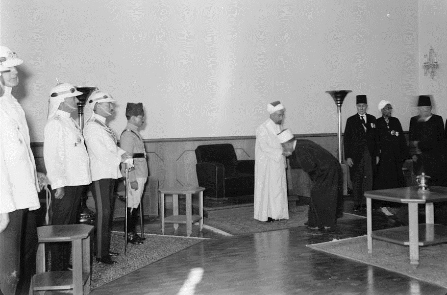 Photo taken in  Amman on the 24th anniversary of Arab revolt under King Hussein & Lawrence, celebration Sept. 11, 1940. The Emir is seen receiving the Islamic religious officials, officers of the Arab Legion [on] the left. Date Created/Published: 1940 September 11. Credit/Repository: Library of Congress Prints and Photographs Division Washington, D.C. 20540 USA.