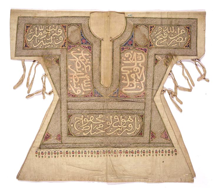 "Inscribed with much of the text of the Koran, this eighteenth-century linen Shiite Muslim battle tunic, most probably from Iran or southern Iraq, also bears inscriptions in praise of the prophet Muhammad and of his son-in-law, Ali. It is eloquent testimony to the place of religious commitment in all aspects of life in the Islamic world. Across the shoulders is inscribed verse 13 of Surah 61 (""al Saff,"" or Battle array): ""Help from God and a speedy Victory. Photo: Librray of Congress, USA."