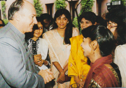 Mawlana Hazar Imam, His Highness the Aga Khan, talking with graduating students at a luncheon held on the Aga Khan University Campus during his 17-day visit to Pakistan in 1991. Photo: Gary Otte/The Ismaili, UK, December 1991.