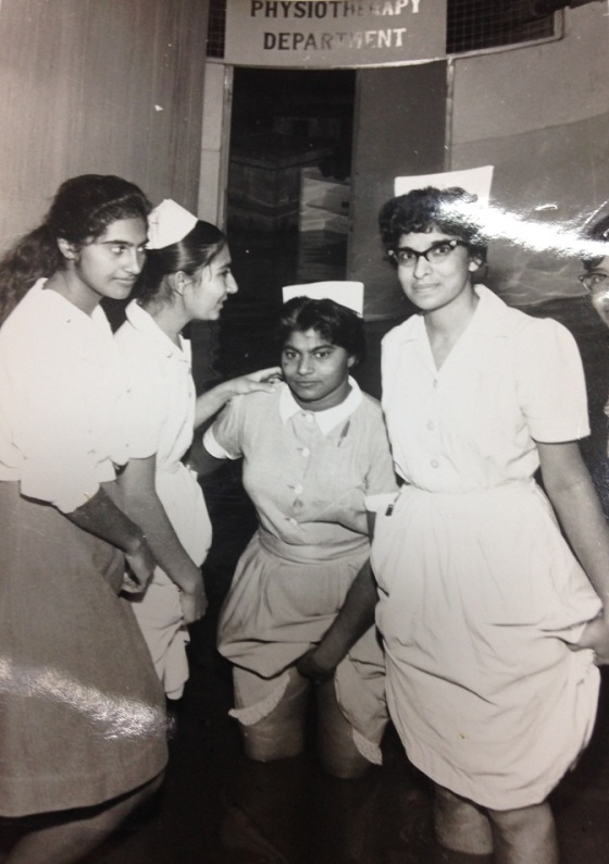 Nurses wading through water when the physiotherapy room got flooded. Photo: Kunden Paatni.