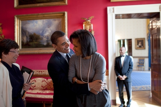 President Barack Obama hugs First Lady Michelle Obama in the Red Room of the White House prior to the National Newspaper Publishers Association (NNPA) reception on March 20, 2009. (Official White House Photo by Pete Souza)