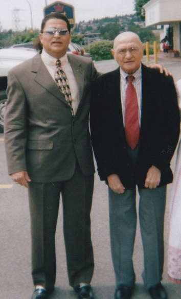 Renowned Ismaili musician and composer, Enoo, pictured with his beloved dad in 2005 before the Vancouver  mulaqat with Mawlana Hazar Imam. Photo: Enoo archives.
