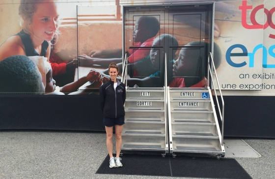 Stephanie in front of the exhibition bus. Photo: Malik Merchant
