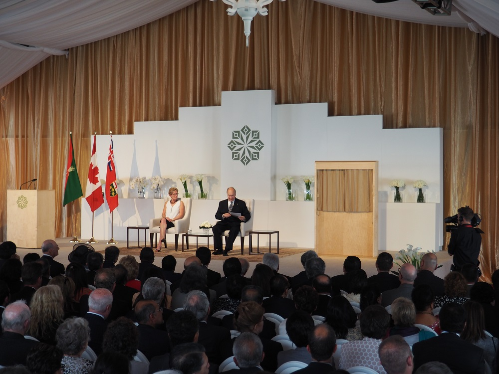 Mawlana Hazar Imam gathers his speech before rising to speak to the audience at the opening of the Aga Khan Park on May 25, 2015. Photo: Simerg/Malik Merchant. Copyright.