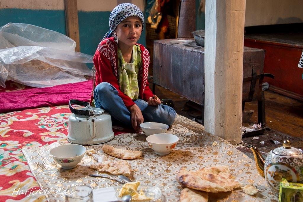 Muslim Harji's portrait of an Ismaili girl in the Wakhan Corridor of Badakhshan. She is seen Little Suranoor having breakfast before getting ready for school in the Village of Namadgut.