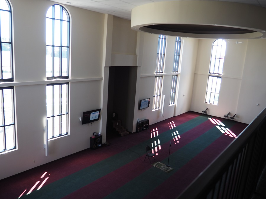 South Nepean Muslim Community Centre. A view of the men's prayer space from the upper floor, which serves the women of the Jamat. Photo: Simerg/Malik Merchant.