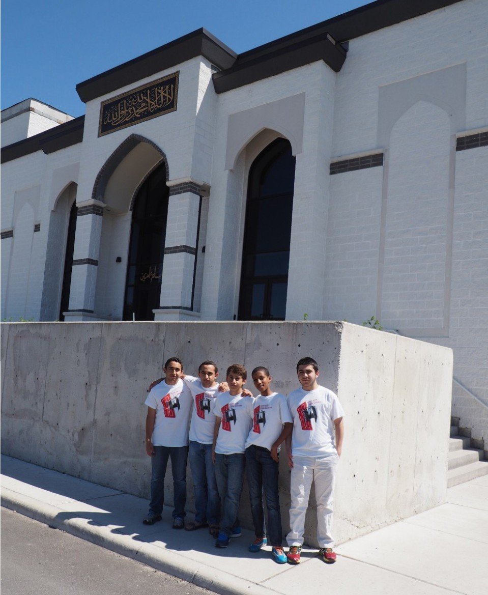 Jami Omar located on 3990 Old Richmond Road in Ottawa's West End. Originally established in 1992, this brand new mosque will be one of largest in Canada when fully completed. Pictured are Muslim youth who were receiving visitors to the mosque, They are  standing by the front of the building. Photo: Simerg/Malik Merchant