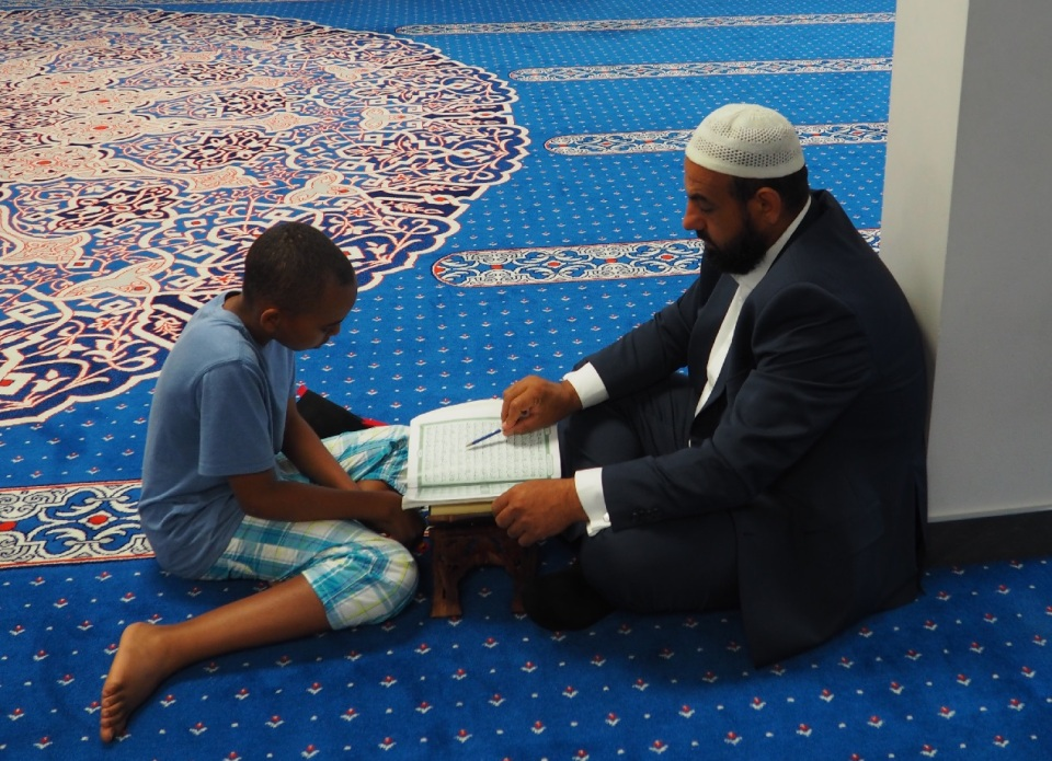 A close up of a very young boy learning how to read the Holy Qur'an at Jami Omar. Brother Mehdi told me that some very young children had already memorized the entire Qur'an. Photo: Simerg/Malik Merchant.
