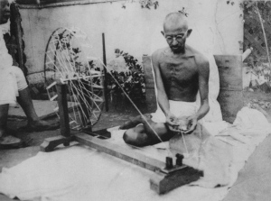 Mahatma Gandhi spinning yarn in the 1920's. Photo: Wikipedia.