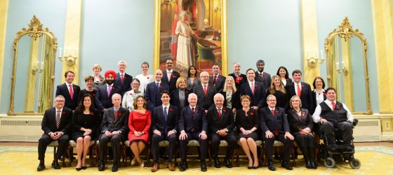 The swearing-in ceremony of the new Prime Minister, Justin Trudeau, seated 5th from left, and his cabinet took place at Rideau Hall. The Governor General of Canada, the Rt. Honourable David Johnston, is seated next to the Prime Minister. Photo: The website of the Governor General of Canada.