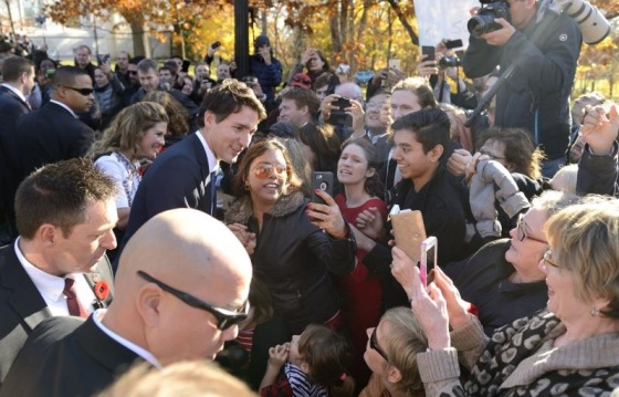 Prime Minister Justin Trudeau was plunged into a selfie ocean as he and his wife, Sophie Grégoire-Trudeau, mingled with the crowd outside Rideau Hall after the swearing ceremony. Photo: MCpl Vincent Carbonneau, Rideau Hall.