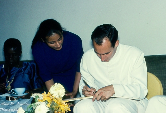 Mawlana Hazar Imam, His Highness the Aga Khan, 49th Imam of Shia Imami Ismaili Muslims, signing an autograph for Roshan Dhanani, Kampala.