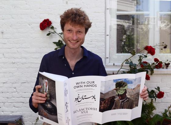 "Frederik van Oudenhoven happily displaying ""With Our Own Hands"" that he co-authored with Jamila Haider. Photo: Facebook page, PamirFoodandLife. The magnificent volume is now out of print, but may be obtained through resellers at Amazon."