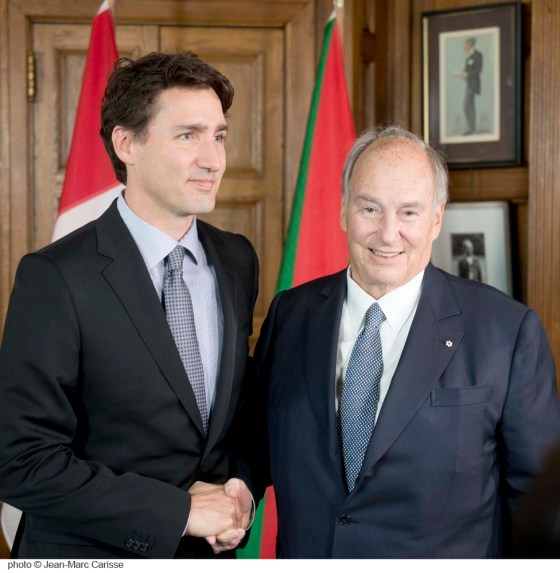 His Highness the Aga Khan looks straight at the camera as he greets Prime Minister Justin Trudeau on Tuesday, May 17, 2016, at the Office of the Prime Minister located at the Centre Block of Parliament Hill in Ottawa. Photo: Jean-Marc Carisee. Copyright.