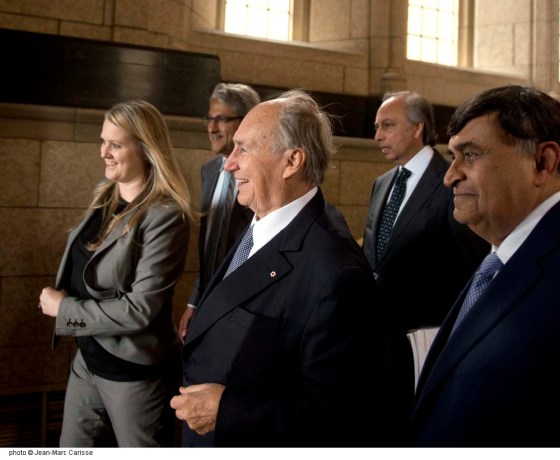 His Highness the Aga Khan has a broad smile as he prepares to leave the Parliament Building after his meeting with Prime Minister Justin Trudeau on Tuesday, May 17, 2016. In the picture with him are Ismaili leaders Shafik Sachedina, based at the Ismaili Imam's headquarters in Aiglemont, France, President Malik Talib of the Aga Khan Council for Canada, and Mahmoud Eboo, the Aga Khan Development Network's Resident Representative to Canada. Photo: Jean-Marc Carisse. Copyright.