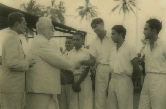 His Highness the Aga Khan (1877 - 1957), 48th Imam of Ismailis, meeting with Mamda Kassam, Premji Vaghela and others at the Gymkhana Cricket Ground in Dar-es-Salaam. Photo: Premji Vaghela Family Collection. Copyright.