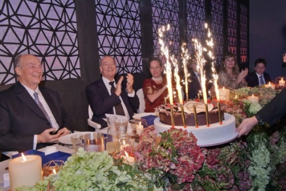 Prince Amyn Muhammad and Princess Zahra applaud as the birthday cake is presented to Mawlana Hazar Imam. Photo: The Ismaili/Zahur Ramji.