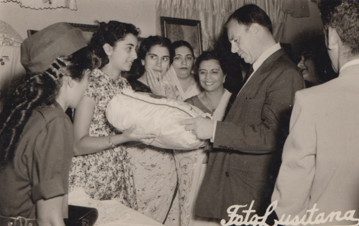Prince Aly Khan admiring a needlework by an Ismaili Student during his visit to Lourenco Marques