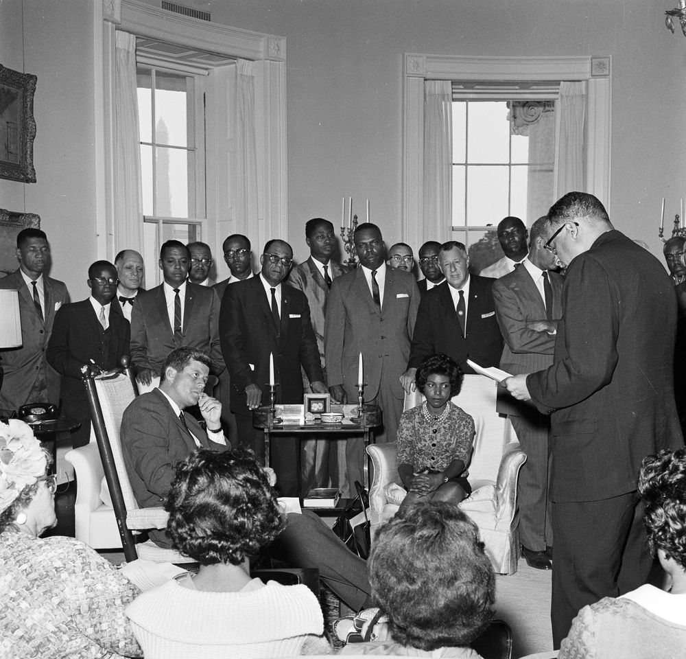July 12, 1961: President John F. Kennedy meets with representatives from the National Association for the Advancement of Colored People. Photo: Robert Knudsen, White House / John F. Kennedy Presidential Library. photo reproduced in Simerg