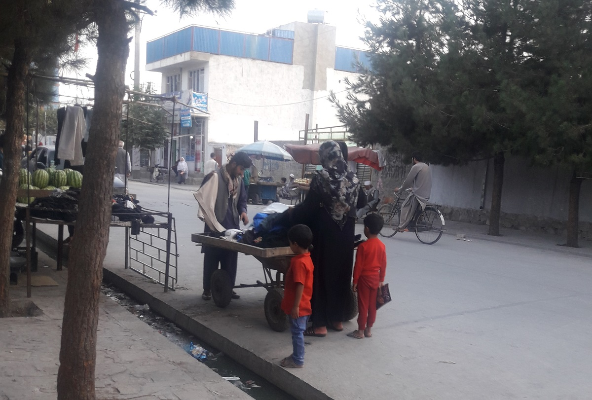 A woman shops at the Qala-e-Fathullah neighbourhood in Kabul.