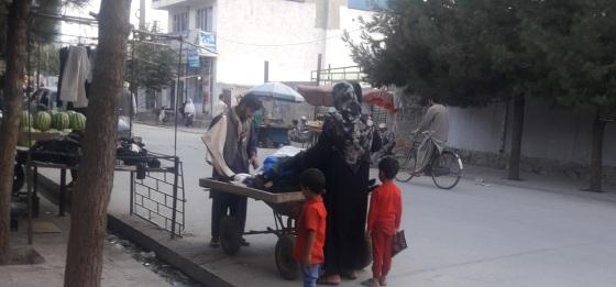 A woman shops at the Qala-e-Fathullah neighbourhood in Kabul simerg